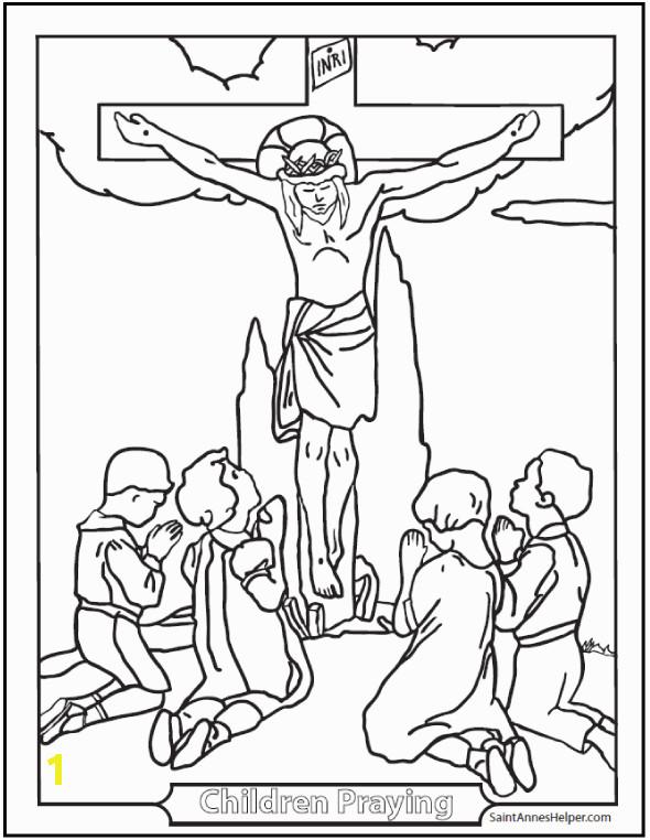 children praying around cross