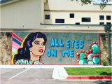 A Building Has A Mural Painted On An Outside Wall All Eyes On Cedar Park Vision Womeninoptometry