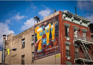 A Building Has A Mural Painted On An Outside Wall Blue Moon Painted Ad In Manhattan