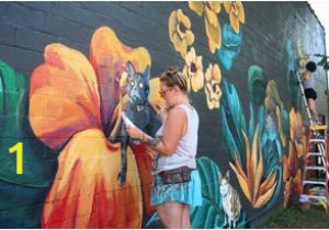 A Building Has A Mural Painted On An Outside Wall Visual Artist Tiffany Clark Has Created 100 Murals In Dayton