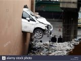 Car Crashing Through Wall Mural Crash Through Wall Stock S & Crash Through Wall Stock