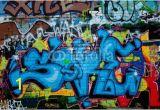 Graffiti Brick Wall Mural Graffiti Detail On the Textured Brick Wall