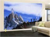 Hollywood Sign Wall Murals Wall Mural Hikers On A Ridge Dwarfed by Cerro torre