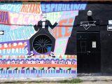 Wall Mural Graffiti Art Graffiti Artwork On Wall Of A Building Photo – Free